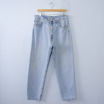 Vintage 90's Levi's 550 light wash tapered leg jeans, men's size 38