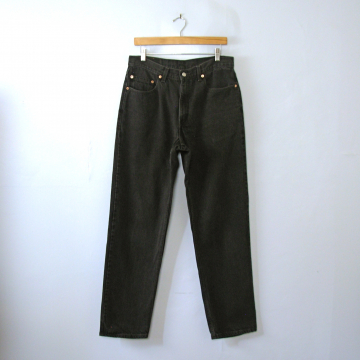 Vintage 90's Levi's 550 black denim jeans with tapered leg, men's size 34