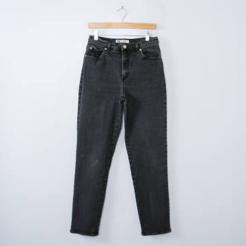 Vintage 90's high waisted black stretch jeans with tapered leg, women's size 10