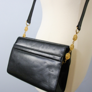 Vintage 80's small black shoulder bag with gold medallions