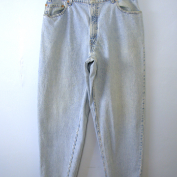 Vintage 80's Levi's 560 jeans, distressed light denim with tapered leg, men's size 36